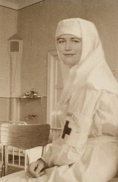 Grand Duchess Maria/Red Cross Nursing Uniform; one of the best photographs I've seen of her, very clear and focussed [Maria was never a red cross nurse. Her head is photoshopped onto her sister Olga's body]