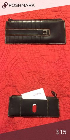 Lodis Audrey Credit Card Case Lodis Audrey Credit Card Case with snap flap closure and eight card slots. Black leather exterior with red piping. Like new condition. Lodis Bags Wallets