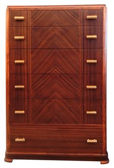 Very elegant 1930s art deco dresser without being pretentious.   I like the richness of the color tone.