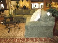 #: 500367  Thomasville 3 piece, curved sectional in a deep green upholstery. The…