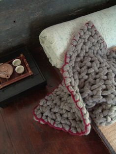 Super chunky knitted blanket with contrasting edge