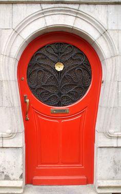 Red Door - photo by sindala de geweldige (sindala), via Flickr;  in Antwerp, Belgium;  door to a 1902 Art Nouveau house designed by architect Van Oenen