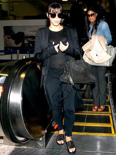 Kim Kardashian arrives at LAX (Los Angeles International Airport) with a growing baby bump on March 17, 2013.