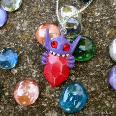The release of Pokemon Omega Ruby and Alpha Sapphire is just around the corner, and with it comes new Mega-Evolutions, including that jewel eating monster, Sableye! Show your excitement for the Hoenn Pokemon Craft, All Pokemon, Pokemon Stuff, Pokemon Necklace, Pokemon Omega Ruby, Mega Evolution, 6th Birthday Parties, Bright Ideas, 4 Life