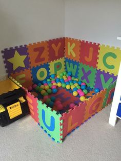 Foam alphabet mats used to make a ball pit