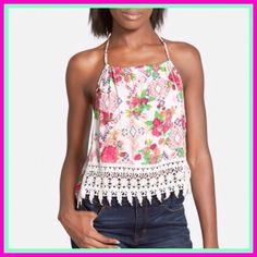 "Crochet Halter Top Crochet Halter Top  A cool halter top is patterned with an island-inspired print and finished with delicate tiers of crocheted lace. - 15 1/2"" length - Ties behind neck - 100% rayon  True to size. Tops"