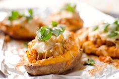 Twice Baked Buffalo Chicken Sweet Potatoes are an easy recipe with creamy bleu cheese whipped sweet potatoes & topped with buffalo chicken, veggies & cheese