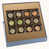 Ghyslain Dark Medalion gourmet chocolates are filled with fine ganaches and then infused with blends of pure cocoa, dried fruits, and essences of fine extracts. Only 64% dark couverture is used in making these delectable chocolates.