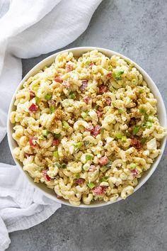 macaroni salad in a white serving bowl