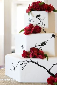 Octogonal wedding cake with branch design accented by fresh roses