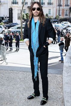 Jared Leto breaks up his all-black outfit with a bright blue scarf