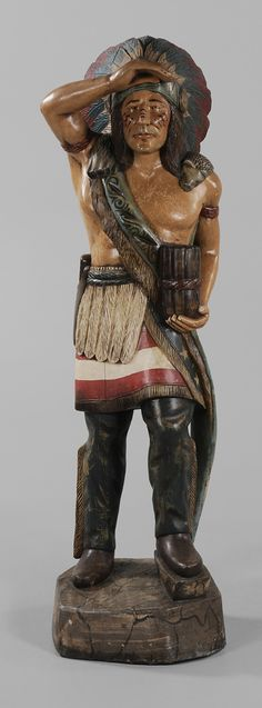 Painted and Carved Cigar Store Indian - Lot 311 from July 2012 Auction.  American, second half 20th century, carved from the solid(?) log with polychrome decoration overall, 73 x 21 x 22 in.    Estimate $800 to $1,200