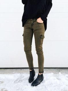 Green pants - black sweater                                                                                                                                                                                 More