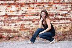 senior photography pose, brick wall
