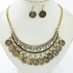 🎁SALE Boho Coin Antique Gold Necklace Earring Set 🎁I'm currently running an additional sale. See listing at the top of my closet for details and end date.🎁  Reduced from $16 to $10!  PRICE FIRM!   This gorgeous set is brand new.  It's versatile and good quality.  This set is antique gold and comes with the necklace and earrings.  The 1st 2 pics are truest to color. Jewelry Necklaces