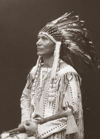 Photo of Charles Eastman (Ohiyesa) in traditional dress