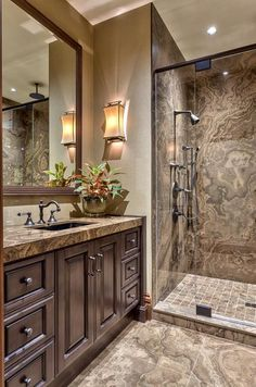 A rustic bathroom with just the right amount of contemporary elements. Bronze plumbing fixtures and cabinet hardware. Asheville Architecture & Interiors.