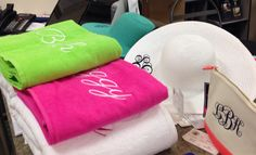 Beach towels and floppy hats sold and monogrammed at Doodlz Designz!