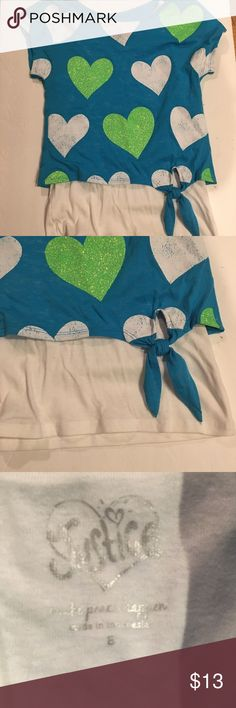 Girls Justice top Cute too that looks like 2 pieces. Crop top on top of a long white top. Has a side tie and a solid color back.  Hearts are sparkly. In excellent condition Justice Shirts & Tops