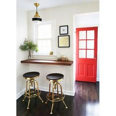 Primary Schoolhouse Cord Hung Light, 997-Raw Brass, Small Opaque Glass, Single Painted Band, 100-Black, SBK-Standard Black Cord | Photo Courtesy of Melissa Maria and Architectural Digest