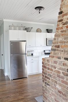 Old Kitchen, Kitchen Paint, Kitchen Redo, White Shaker Kitchen, White Shaker Cabinets, Sherwin Williams Silver Strand, Exposed Brick Fireplaces, Before After Kitchen, Double Sided Fireplace