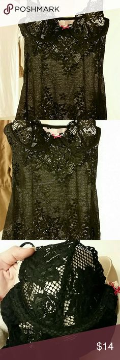 """Victoria's Secret black lace lingerie top/cami Across bottom of underwires 11.5"""" armpit to hem 17"""" marerial is 82% nylon 18% spandex. I tried to show detail on cups/hem using a nude bra/pillow (wish I had a mannequin :/ difficult to capture beauty of this piece) 5.5"""" slit on front left - very sexy! Excellent condition - no snags/pilling. Was a gift & unfortunately a tad small. OFFERS WELCOME Victoria's Secret Intimates & Sleepwear"""