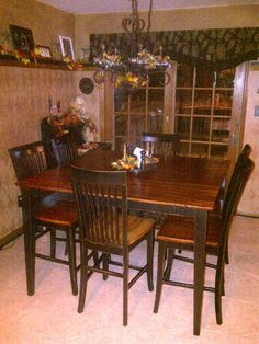 Kitchen table and chairs redo. Was blonde wood; spray painted black and distressed, then stained overtop.