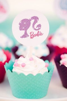 Add a printable Barbie cupcake topper, and a simple cupcake gets a glam makeover.