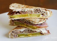 Quesadilla Cuban Sandwich Style -- swiss, ham (pulled pork is best), kosher pickle, and mustard.