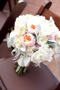 Bride's bouquet (stems wrapped with provided ribbon and brooch and stems showing at the bottom)  Bridemaids a smaller and simpler version