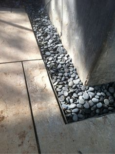 Mexican pebbles gutter around the stone patio.