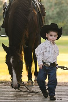 Little cowboy.  -     What a Heart-Breaker he's gonna beLOL! He's seriously too adorable, leading the horse with such confidence❗