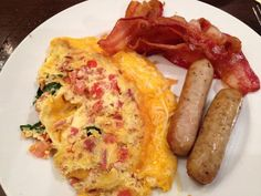 Paleo low carb breakfast - spinach and tomato inside a scrambled egg with bacon & sausage. Yum!