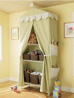 curtained nursery shelving. This one's from Land of Nod, but you could make your own with a shelving unit and some fabric.