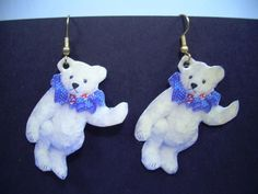 All the charm of real little mohair teddy bears to adorn your ears. Features a mohair bear with blue ruffle. They are glazed paper and cloth with gold tone brass ear hook findings. They were hand made by soft sculpture artist Cathy Peterson. Bear Art, Soft Sculpture, Terrier Mix, Roosevelt, Independence Day, Charity, Teddybear, Whimsical, Arts And Crafts