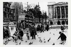 Children feeding the pigeons in Old Market Square in about 1960