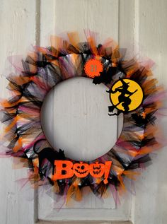 Wreath for Halloween. Basis of cardboard, painted with white paint and covered with tulle.