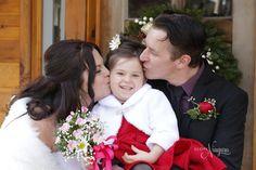 Cute little flower girl at her parents elopement wedding at The Little Log Wedding Chapel in Niagara