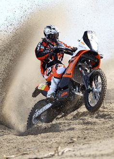 This is a good image of the KTM Dakar, because the image is taken whilst the sand is spraying up behind the bike.