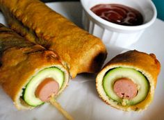 Zucchini Weenies / I just had to giggle when I saw this corn dog recipe from BetsyLife — a hot dog, inside a zucchini, inside a fried layer of batter! Does the zucchini cancel out the deep-frying? Is this a healthier, happier corn dog?