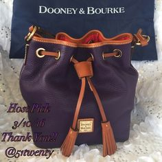 💯% Authentic Dooney & Bourke purse 100% Authentic💋💋purple Dooney & Bourke purse. Drawstring handle to close the top. Signature red inside the purse. Yes it authentic. Dust bag and paperwork included. Dooney & Bourke Bags Shoulder Bags