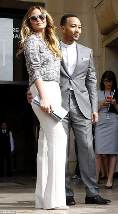 Stylish arrivals: Chrissy Teigen and John Legend opted for coordinating grey and cream loo...