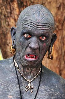 This man made the Guinness Book of World Records, for being the most tattooed man in the world....100% of his body is tattooed. - Some blacks want to be white ( M. Jackson ) and some whites want to be black.( this one ) never satisfied with the works of the creator.