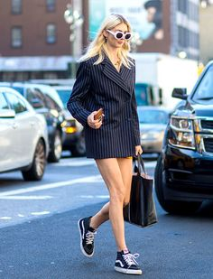 Kelly Connor proving that Vans are making a serious return to street style. Pair with an oversized blazer rendered as a dress for a cool vibe.