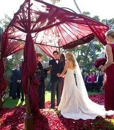 Dreamy altar with Marsala red fabric #marsala #wedding
