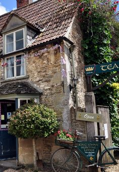 A fleeting blue sky opens over John King's Hunting Lodge and Tea Rooms in Lacock, England