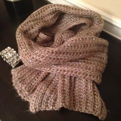Gorgeous Sequins Sparkle Knit Scarf This gorgeous chunky knit scarf has metallic accents and sequins throughout. Multicolored yarn with subtle mauve, gold and green color variation. This scarf will keep you warm and stylish on chilly days! Accessories Scarves & Wraps