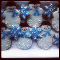 Snowmen and snowflake cookies by Tina's Sugar Shoppe, via Flickr