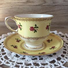 Beautiful Vintage Queen Anne Bone China Tea Cup and Saucer made in England / Pink Roses and Yellow w/ Gold Trim / Tea Time / Tea Party This is a beautiful Queen Anne bone china tea cup and saucer made in England. It features a lovely pink and yellow tiny rose pattern and gold trimming.
