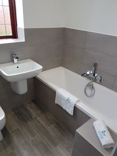 Gray and white bathroom with double bath and tiled bath paneling. Gray and white bathroom with double bath and tiled bath paneling. Grey Marble Bathroom, Best Bathroom Tiles, Small Bathroom Layout, Gray And White Bathroom, Master Bathroom Shower, Modern Bathroom Design, Bathroom Interior Design, Downstairs Bathroom, Bathroom Inspo